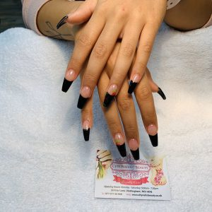 black colour tips with flower designs