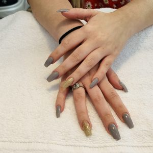 grey polish and golden glitter on coffin nail shape extensions