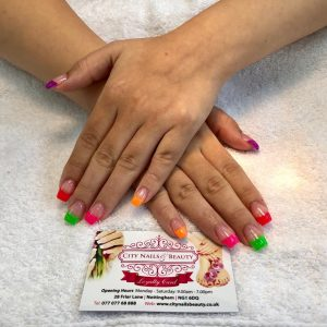 multi colour tips design on square nail extensions