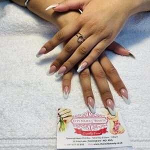 v shape white tips design on nail extensions